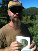 Jeff and his Tahoe Rim Trail 100 Mile Endurance Run belt buckle.